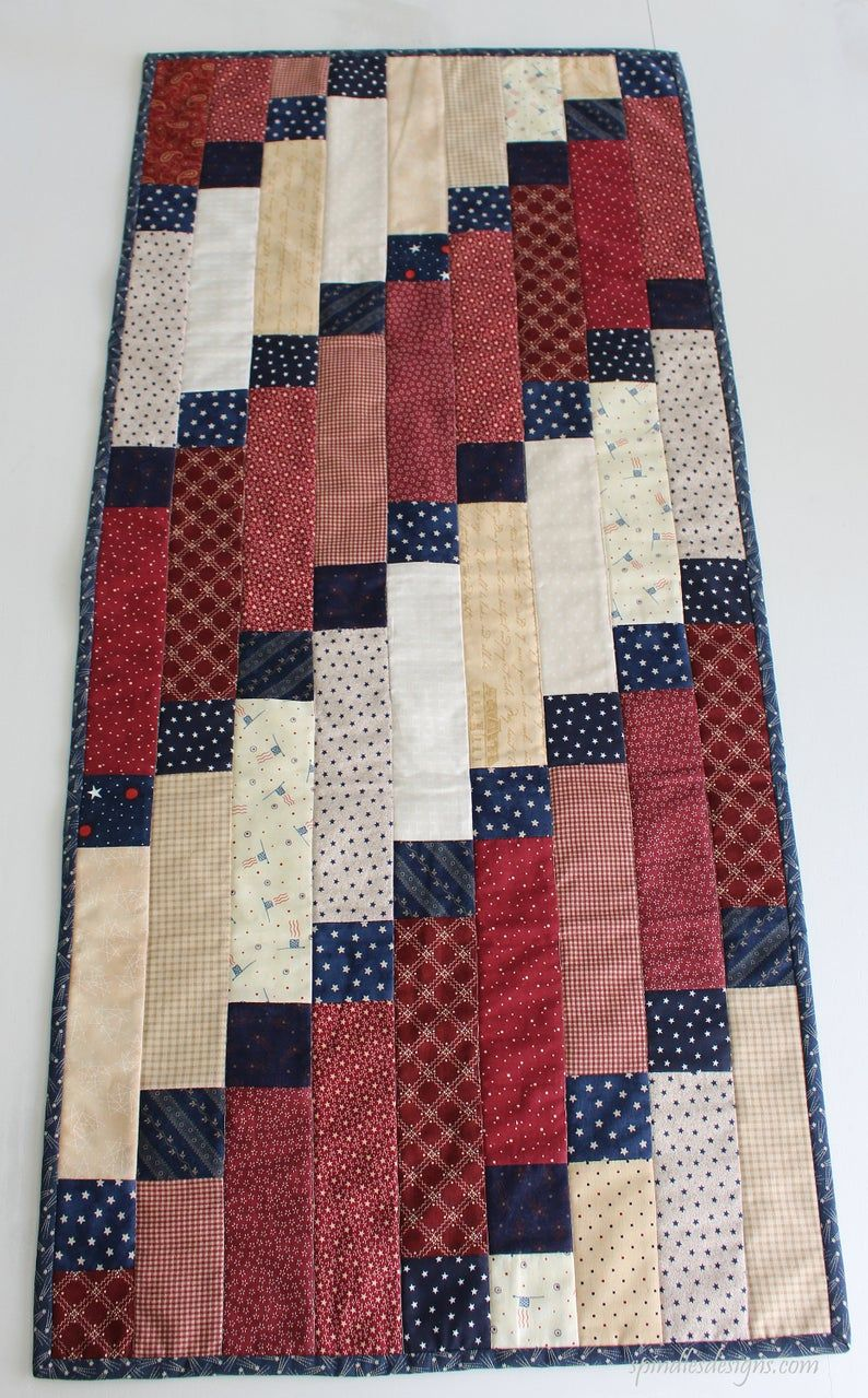 Table Runner, 4th of July Table Runner, Americana Table Runner, Quilted Table Runner, Quilted Patchwork Table Runner is part of Quilted table runners patterns, Patchwork table runner, Quilted table toppers, Quilts, Patriotic quilts, Quilt patterns - 4th of July table decor  Sewing machine quilted and hand bound  It will look great on any table or try adding some flair to your 4th of July barbecue   This ready made item will ship in 35 Business days  Makes a great gift