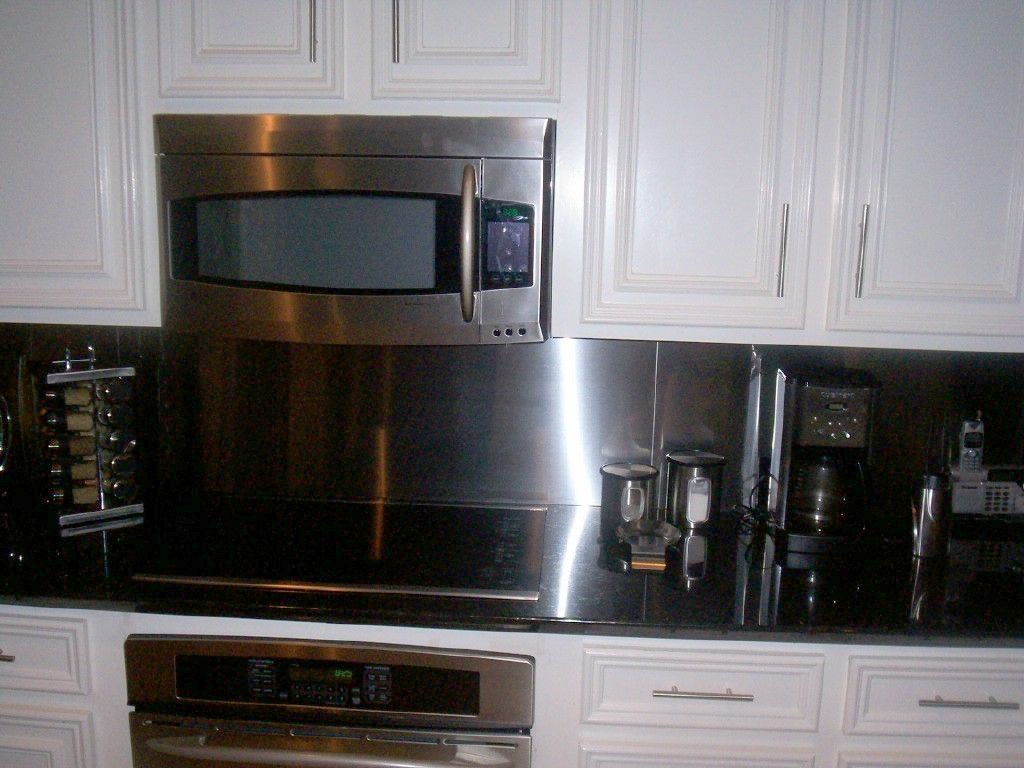 Black Counter With Stainless Steel Backsplash Kitchens I