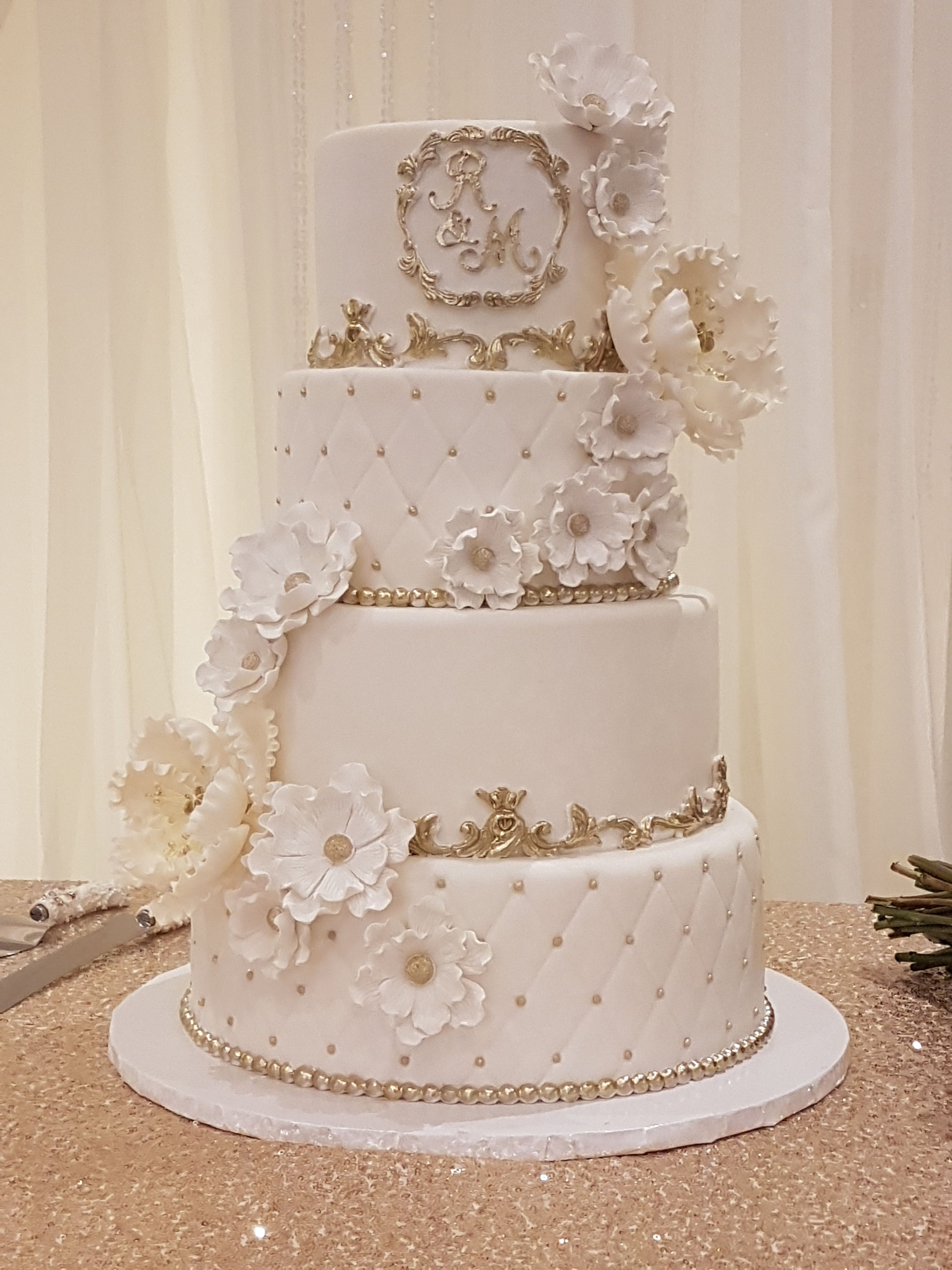 red gold and white wedding ideas%0A White and gold wedding cake with cascading floral pattern