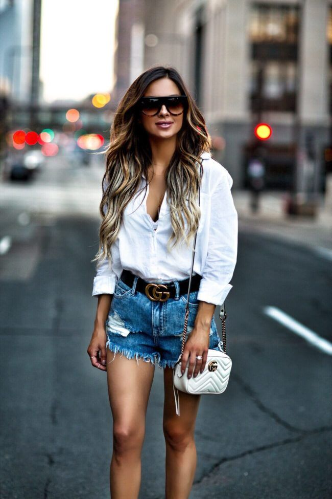 16caa32be3d6 fashion blogger mia mia mine wearing a white button down and distressed  denim shorts with a gucci belt