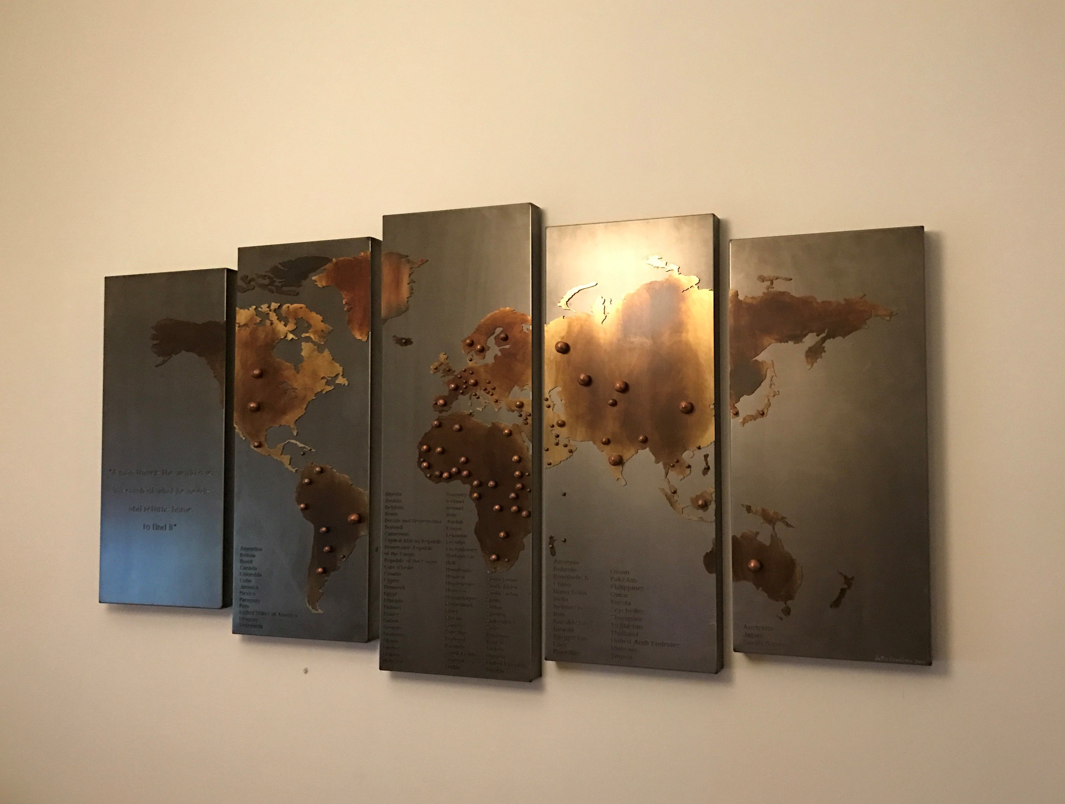 Custom made map of the world with steel and treated brass!