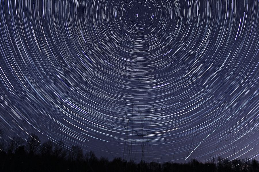 To honor International Dark Sky week, I captured these star trails across a field in the southern Adirondacks. I thought I'd share and hope you enjoy. There is still a some light pollution (lower right portion of the frame) from the City of Saratoga 20+ miles away. April 6, 2013.(This was my first successful attempt at something like this, I think it turned out pretty nice)