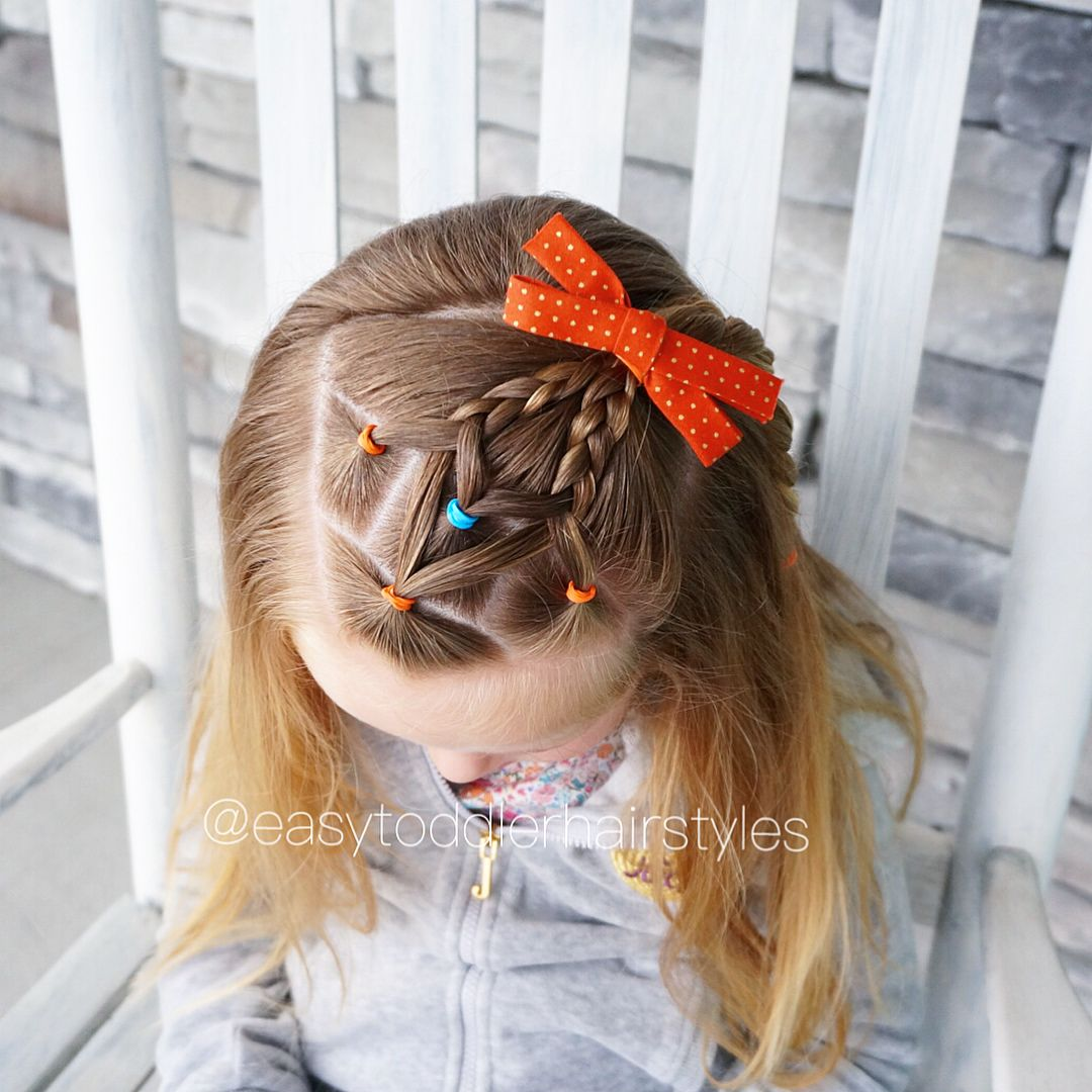Elastics and diagonal braids I parted her hair on the opposite side