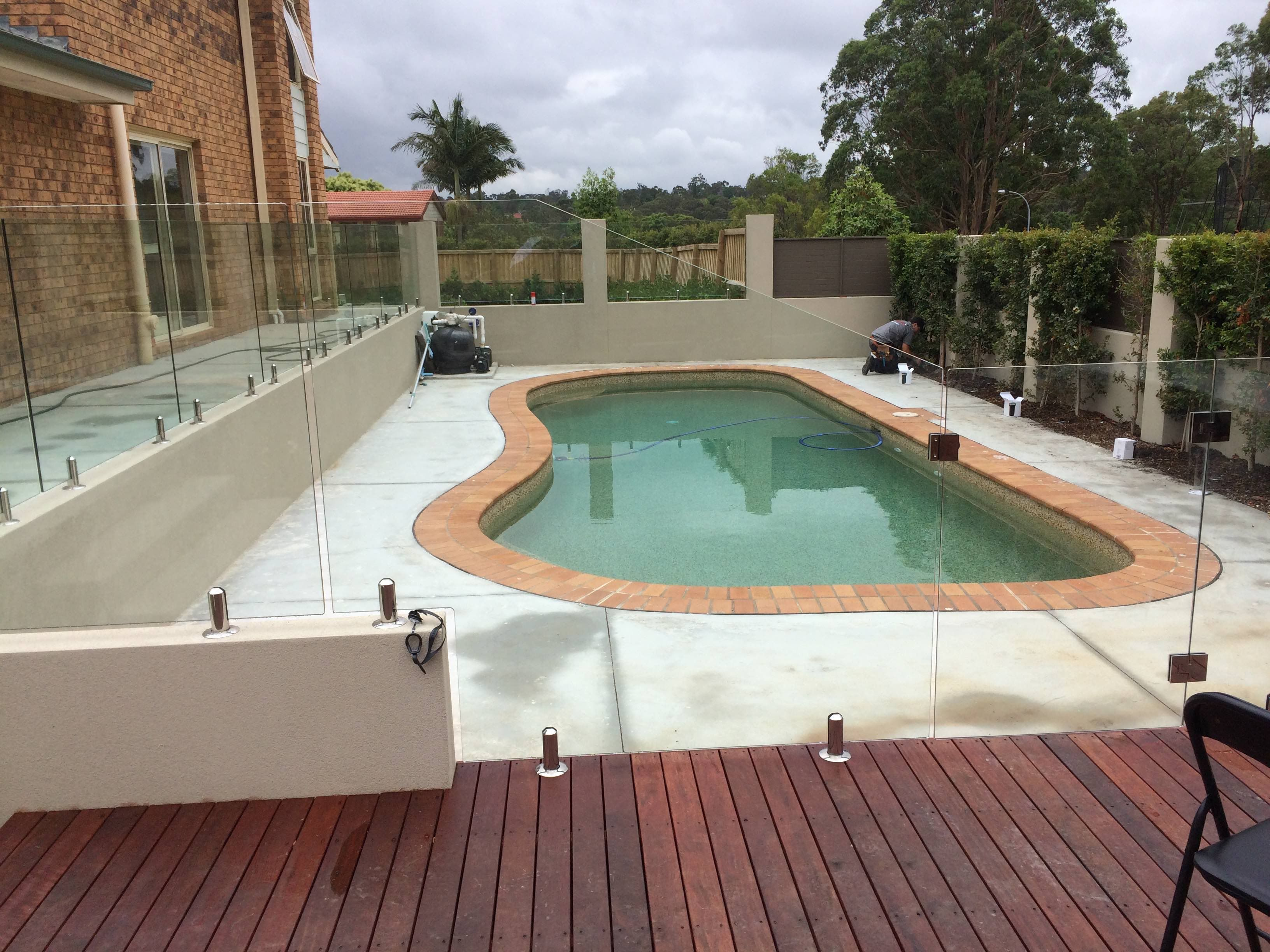 Custom Raked Glass Pool Fence Panels Sydwest Fencing Backyard Fences Pool Fence Glass Pool Fencing