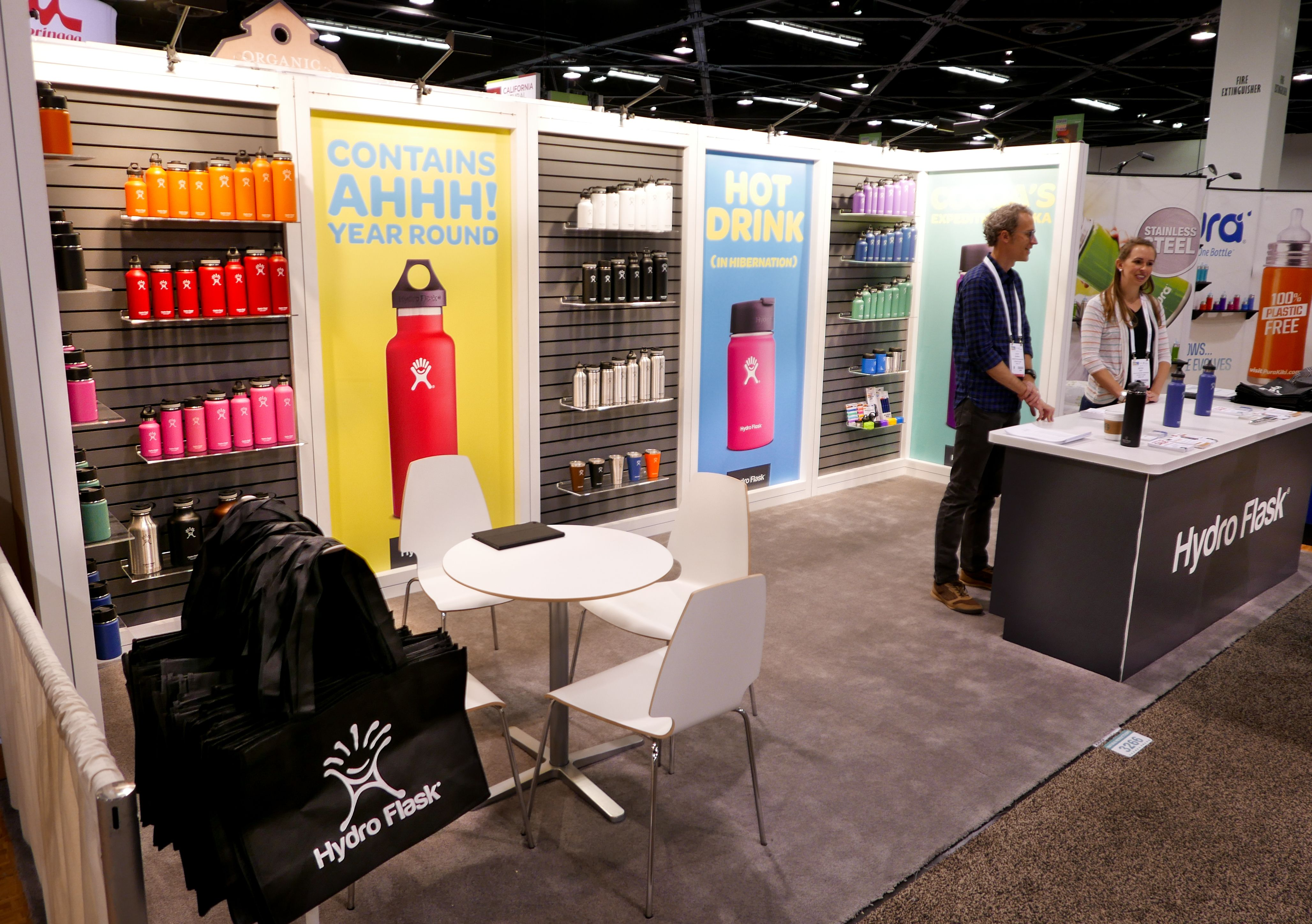 Trade Show Booth Walls : Simple slat wall and large colorful graphics help make