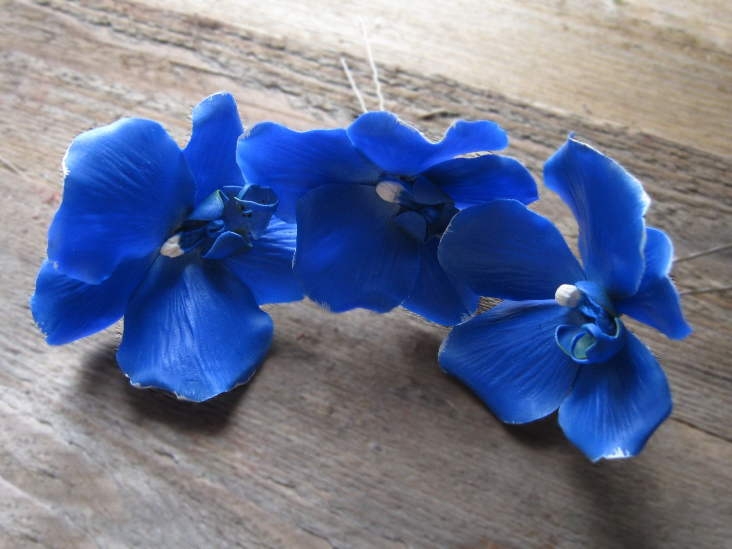 Royal blue hair flower orchid hair pin blue wedding floral hair royal blue hair flower orchid hair pin blue wedding floral hair accessory orchid hair clip polymer clay orchid hair piece tropical flower izmirmasajfo Image collections