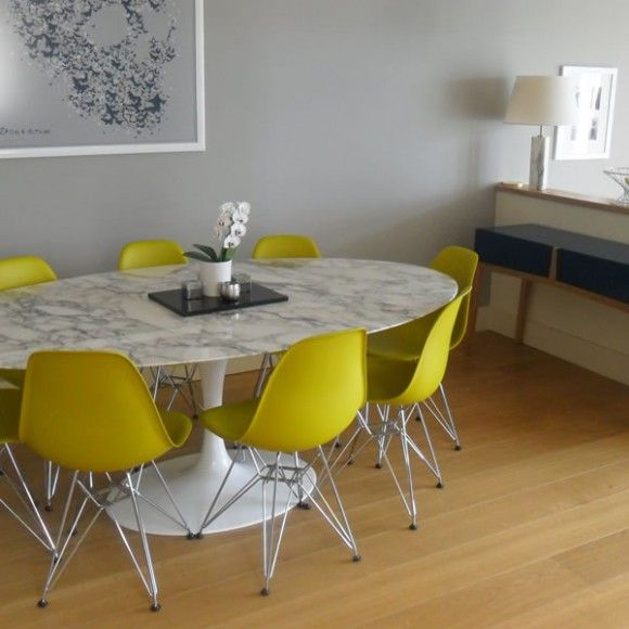 Knoll Saarinen Marble Oval Dining Table With Bright Colored Chairs