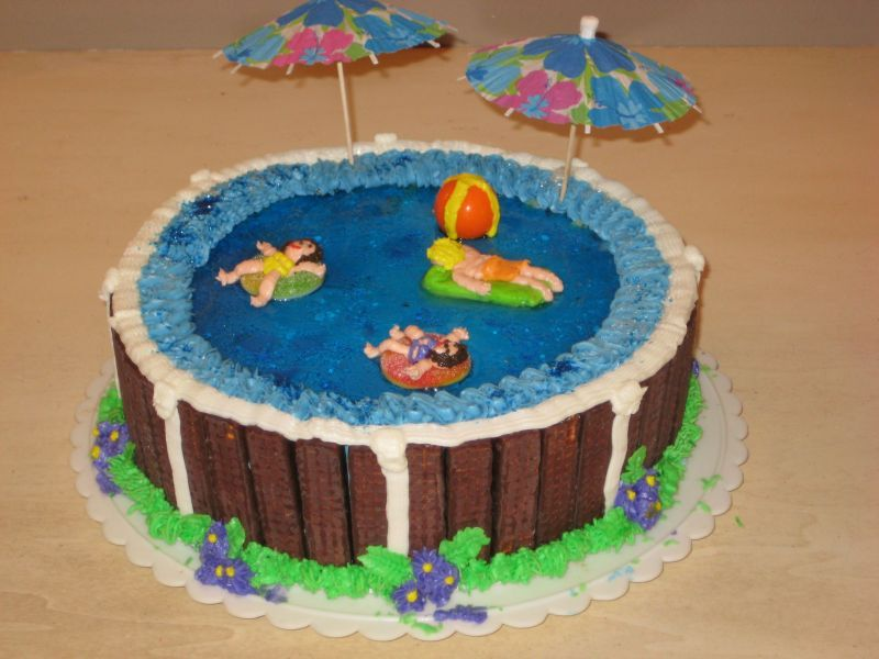 Swimming Pool Cake Ideas we love these swimming pool themed cupcakes we suggest removing the flower from Swimming Pool Cake