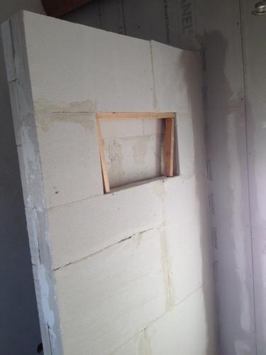 Het stucen van een inloopdouche, van 1 vierkante meter, muur hoogte ...
