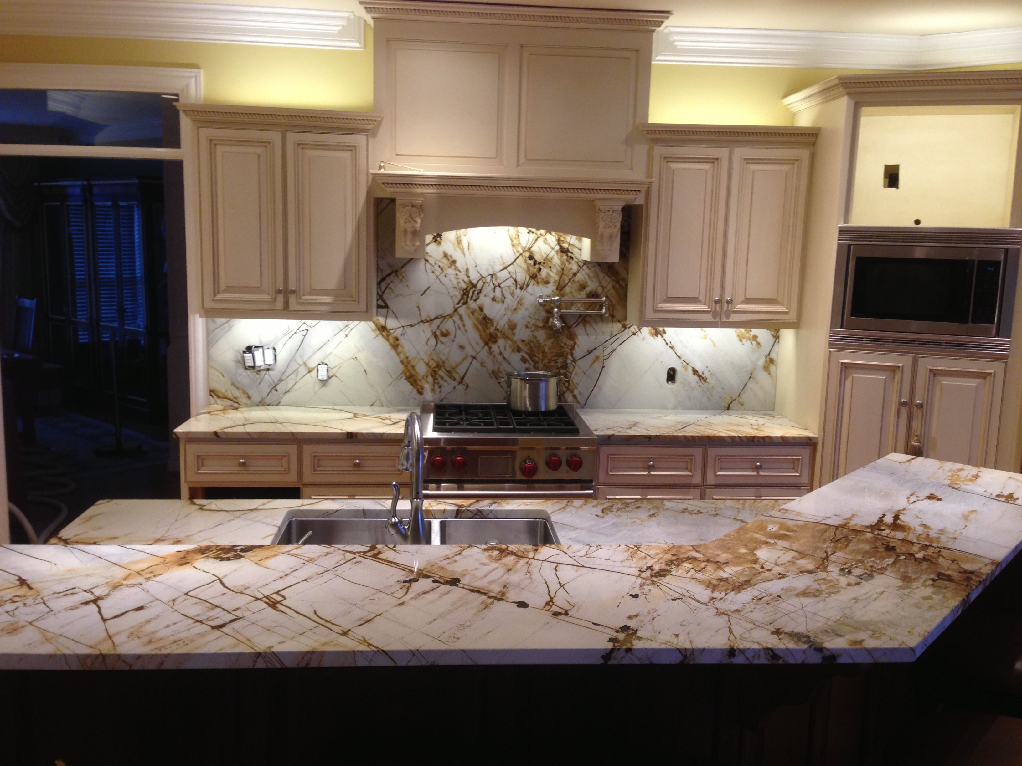 Granite With Cream Cabinets Roma Imperiale Quartzite With Full Height Backsplash And Cream