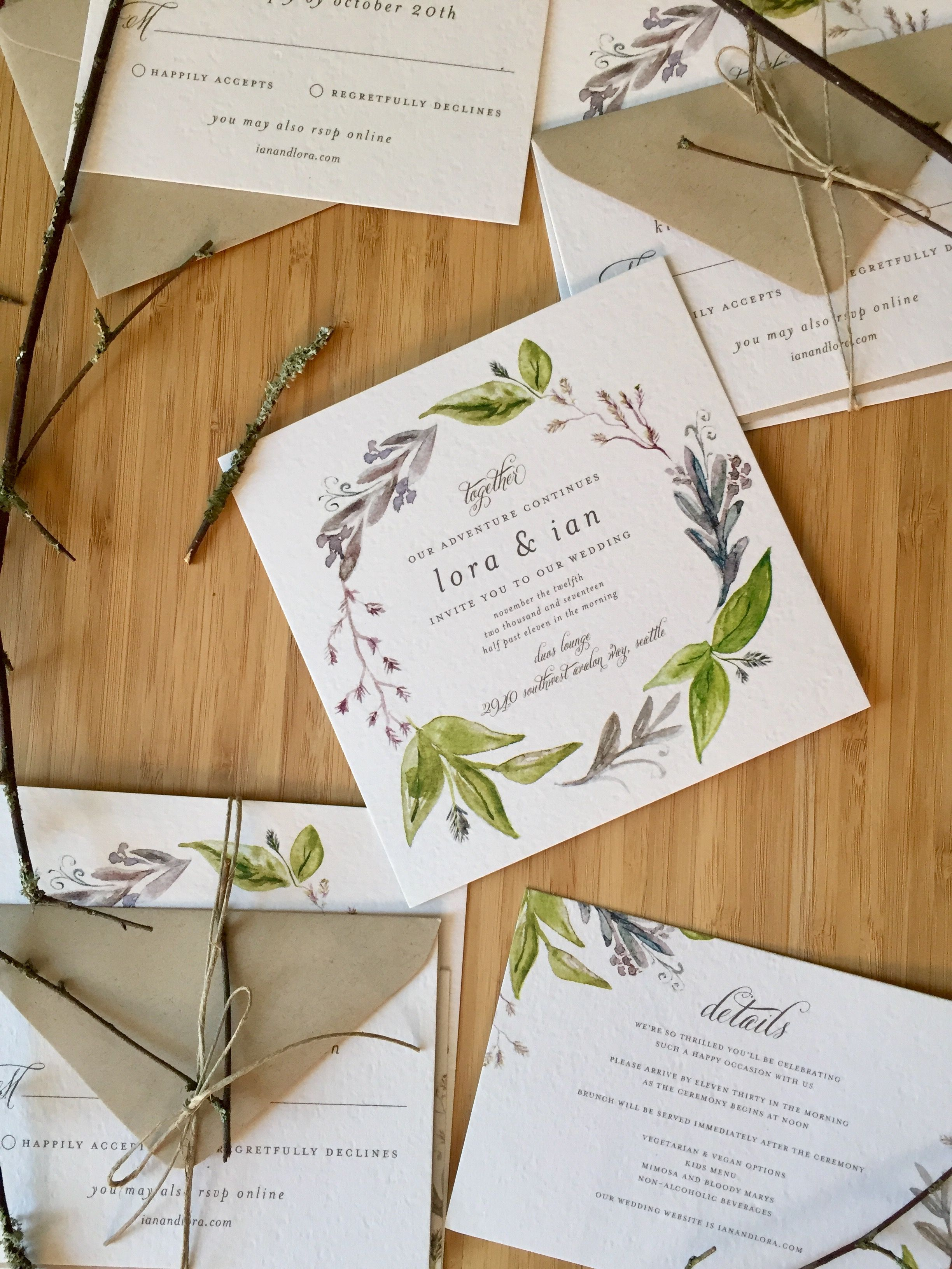 Botanical wedding invitations tied with twine and sticks Rustic