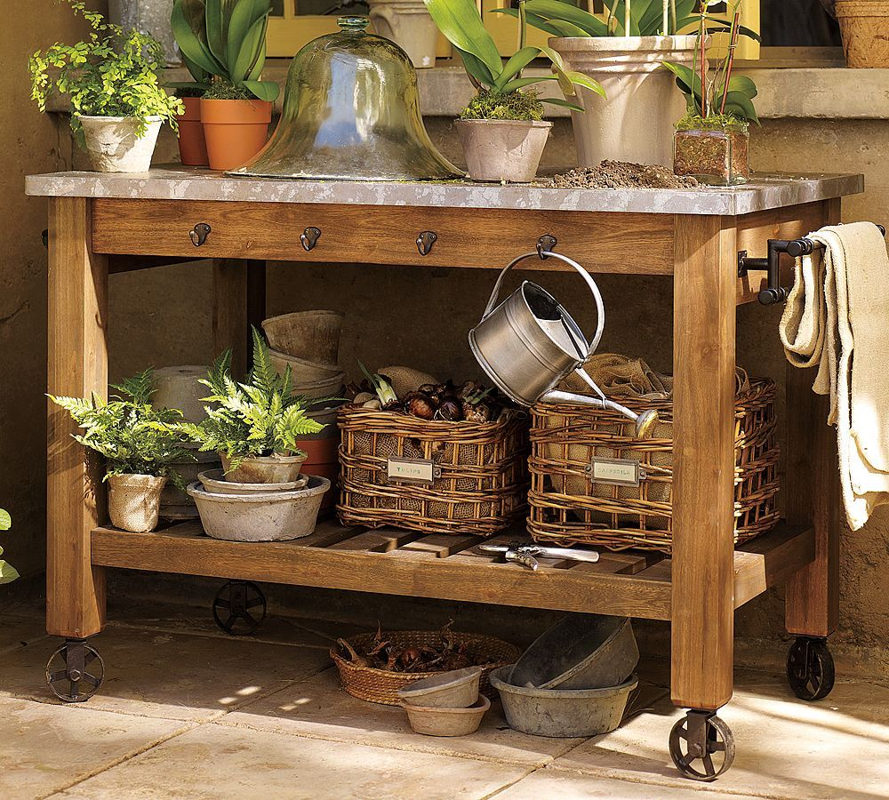 galvanized & wood potting bench. like the casters.