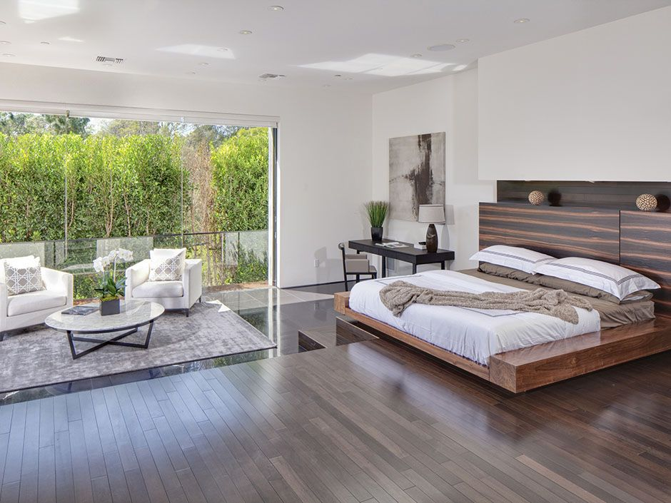 This contemporary and spacious master suite opens