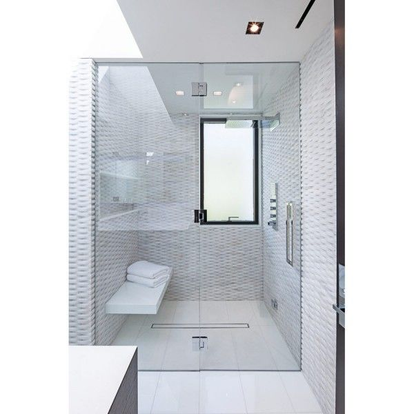 modern bathroom with glass door and textured white tiles