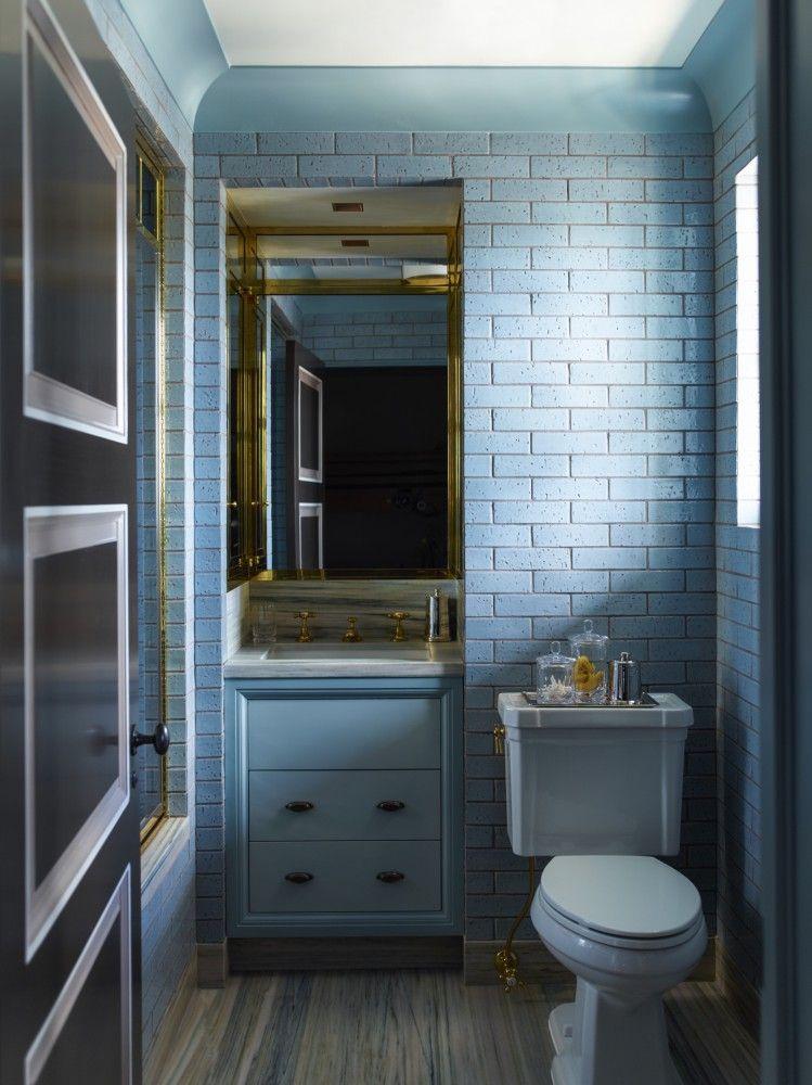 Blue bathroom features a blue brick tiled