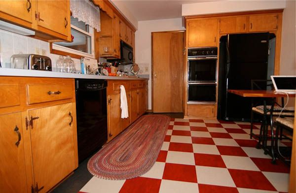A 1965 kitchen updated with red checkerboard linoleum floor tile ...