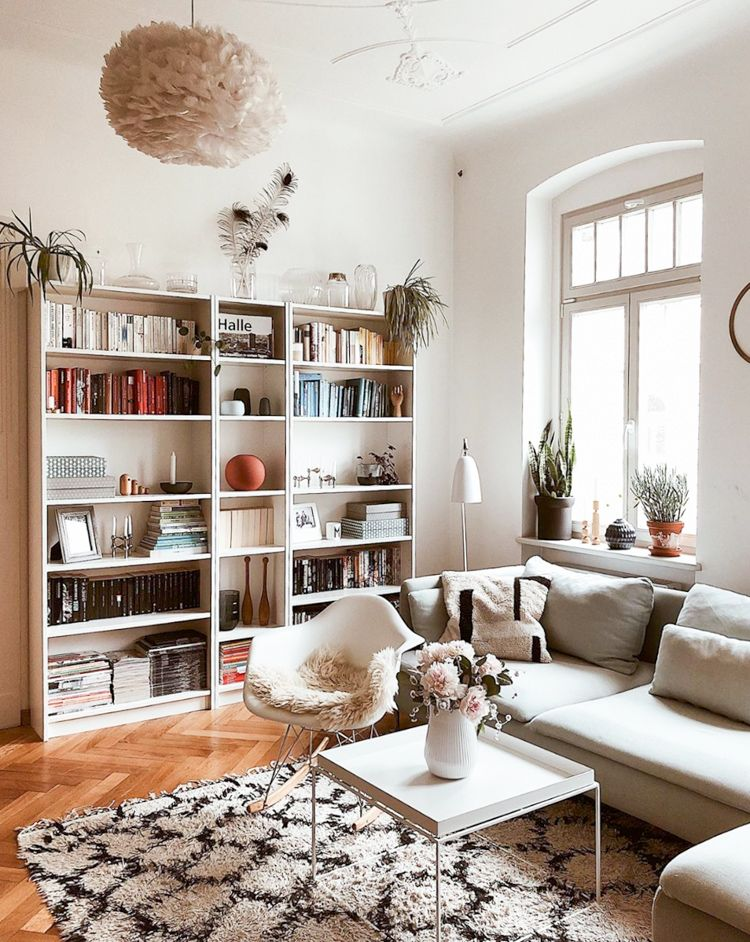 Photo of Relaxed sitting room with large book shelves
