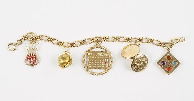 A 14 Karat Yellow Gold Charm Bracelet Apr 30 2016 Susanin S Auctions In Il Gold Charm Bracelet Gold Charm Charm Bracelet