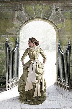 Beautiful Young Victorian Woman Walking Through A Stone Archway by Lee Avison