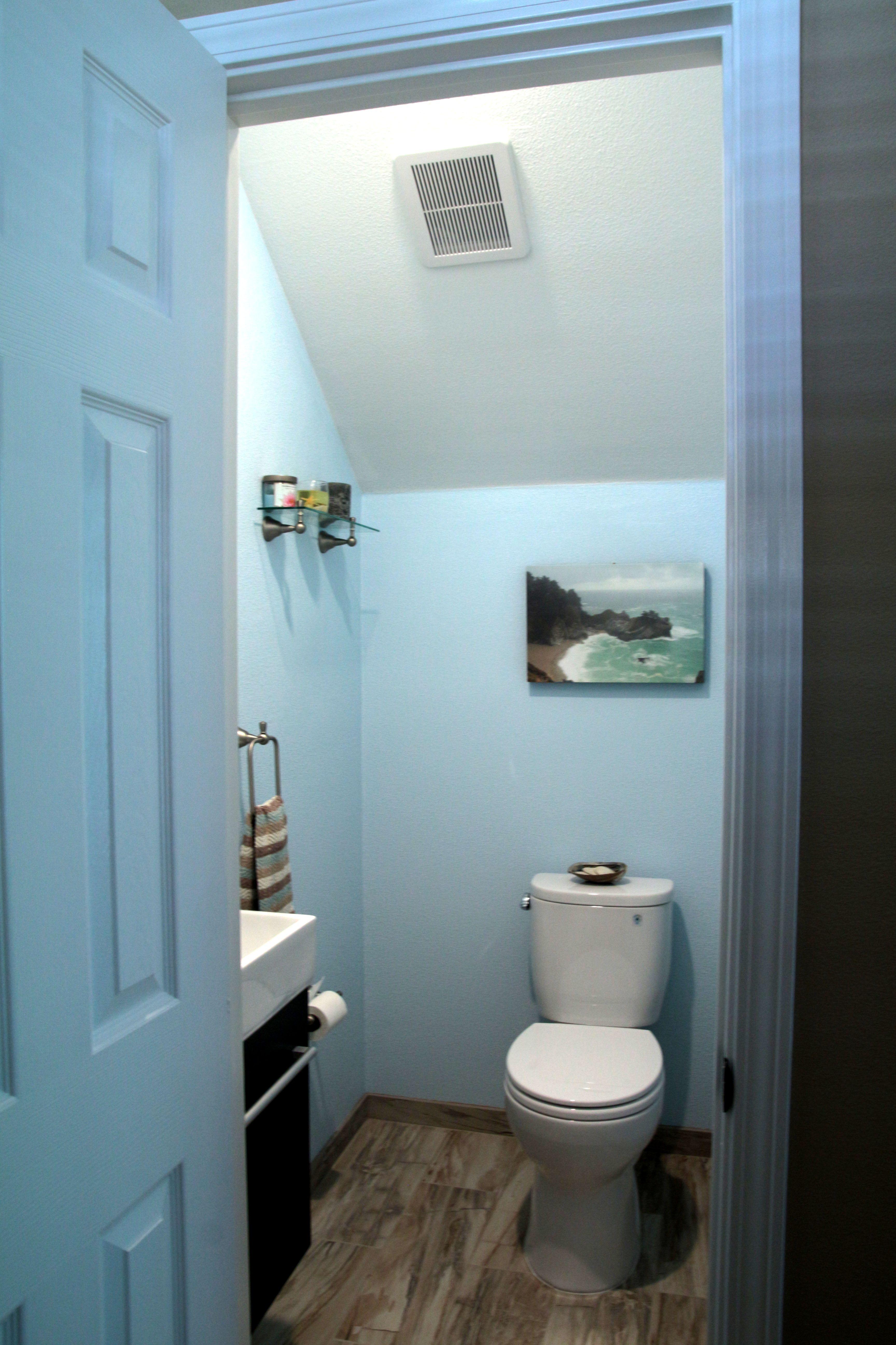 Small bath under stairs Floating sink vanity