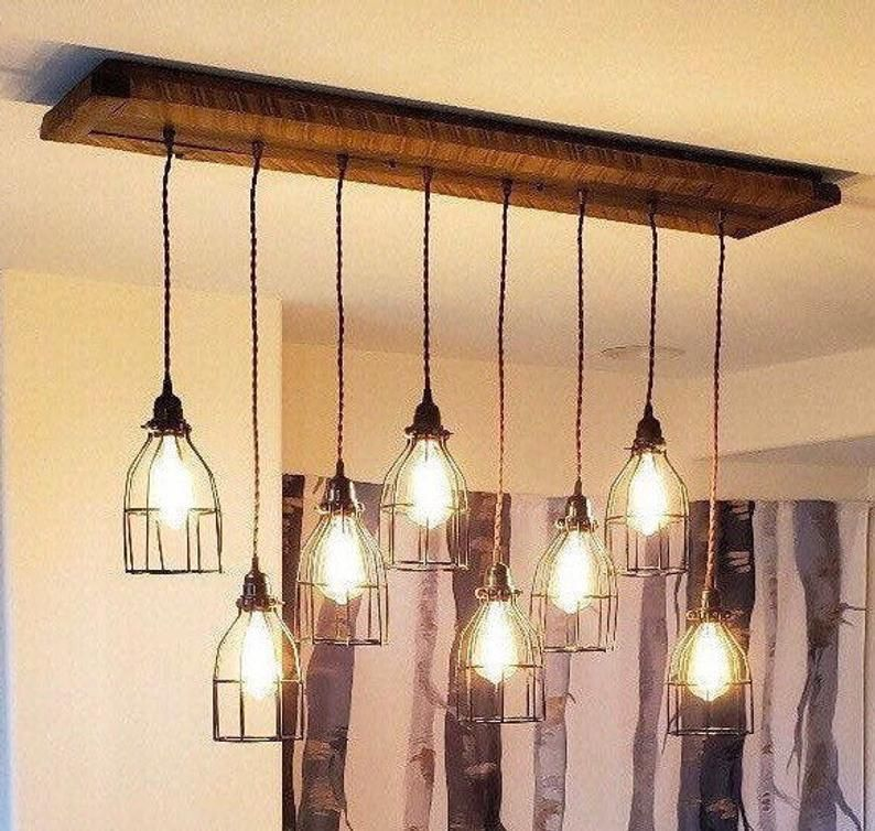 The Eagles Nest Rustic Barn Wood Chandelier In 2020 Pendant