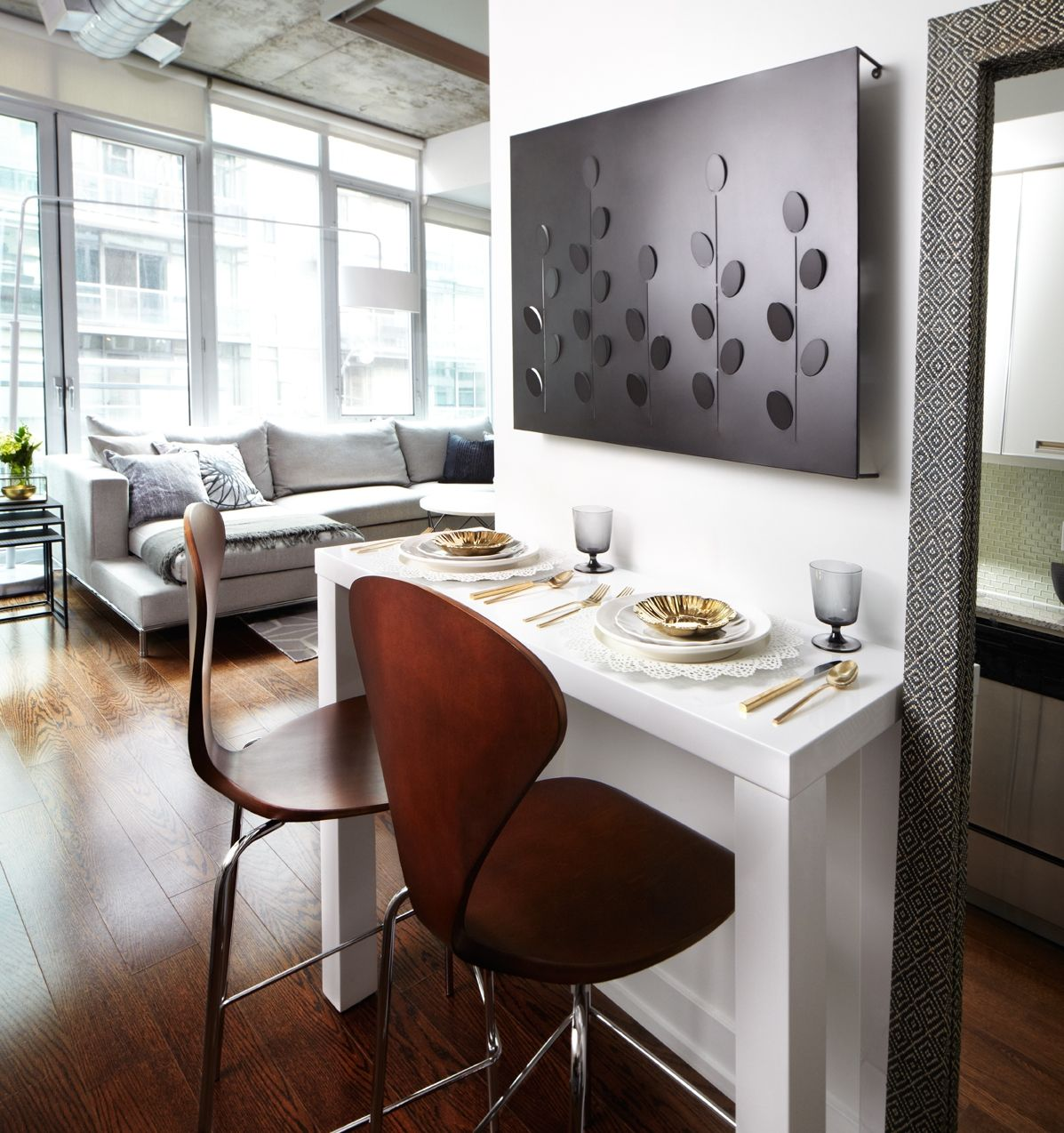 contemporary condo dining nook with white lacquer bar table and