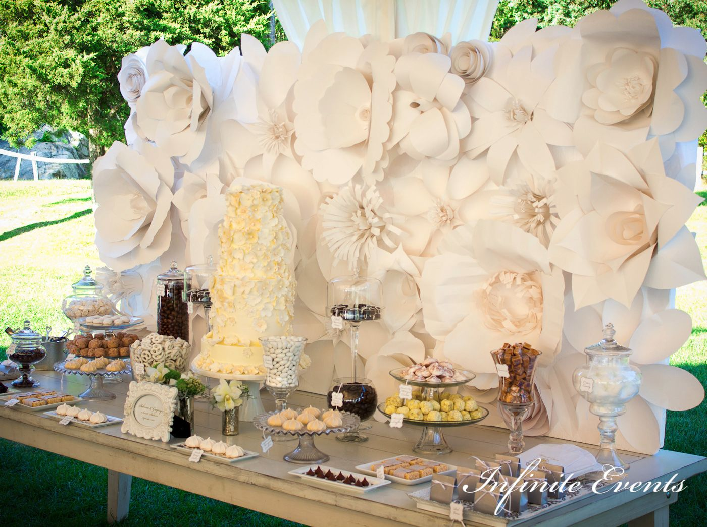 wedding shower candy buffet ideas%0A Paper Flower Backdrop  Candy Buffet by Infinite Events