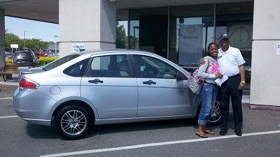 Folger Subaru Internet Sales Consultant Bill Barber with Ms. Strait and her 2010 Ford Focus sedan!