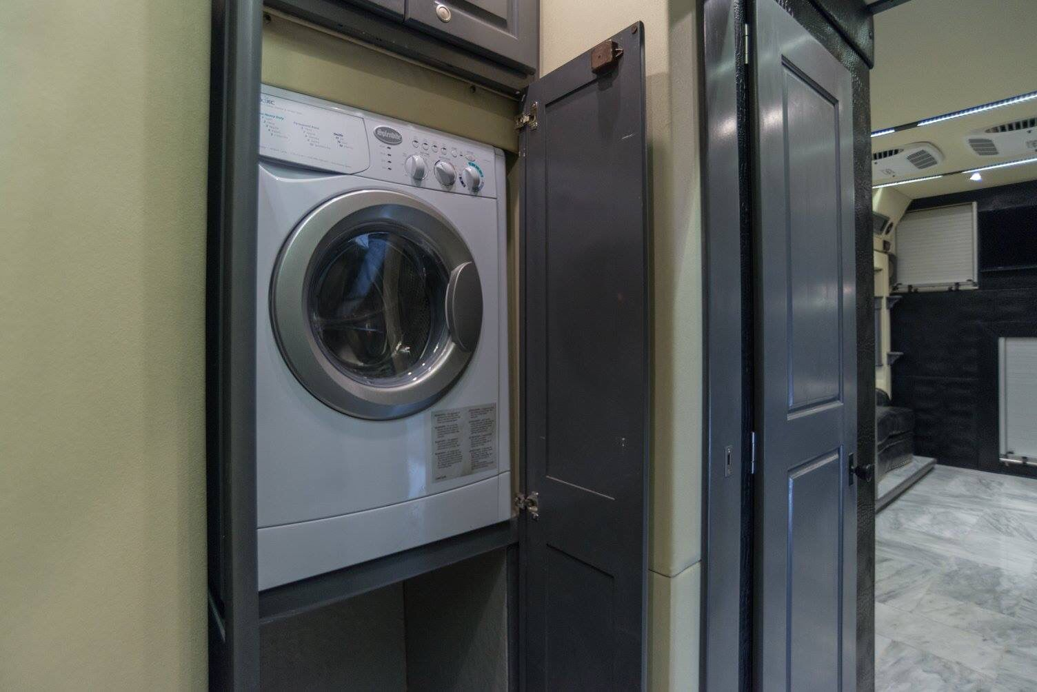 Washer & dryer in a bus. et your bus conversions done at Fox Trailer Servive