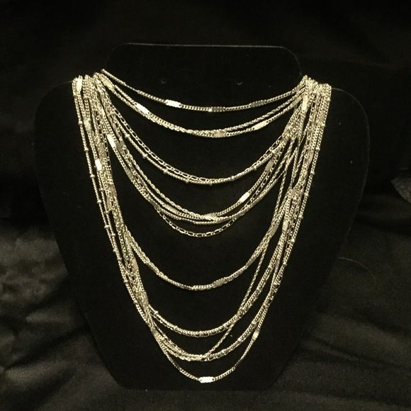 """Multi-Strand Chain Bib Necklace Delicate layers of fancy bar-curb, rope, figaro and satellite chain elegantly drape from a black diamond pavé -embellished hook and ring closure. light antique silver-plated nickel-free 25"""" approx. length hook + ring closure Chloe + Isabel Jewelry Necklaces"""