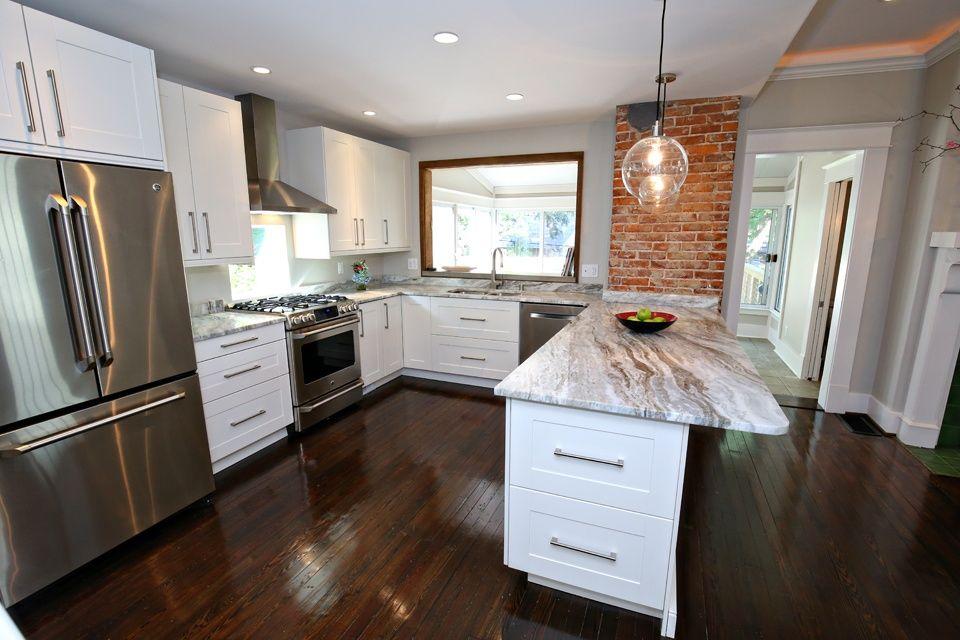 Contemporary Kitchen with U-shaped, Pendant light, Hardwood floors, European Cabinets, Pental Fantasy Brown Satin Quartzite
