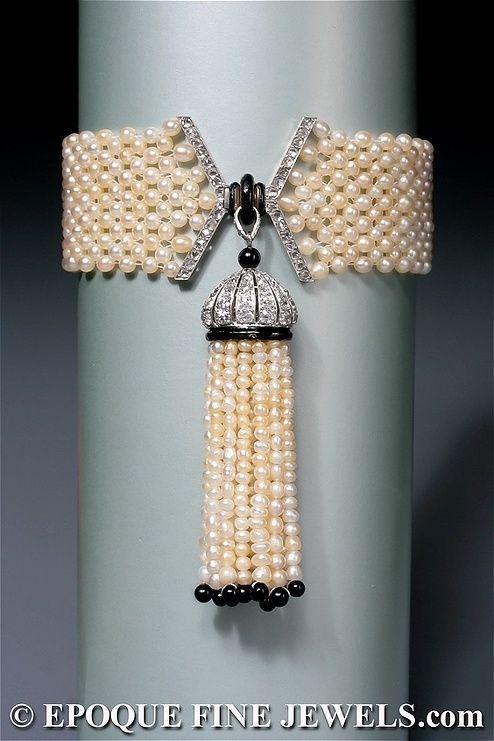 An early Art Deco natural pearl, enamel, onyx and diamond tassel bracelet by Mauboussin, Paris, circa 1920. by shauna
