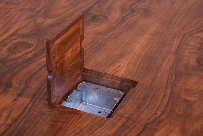 Install an electric outlet in the office conference table for Hardwood flooring outlet