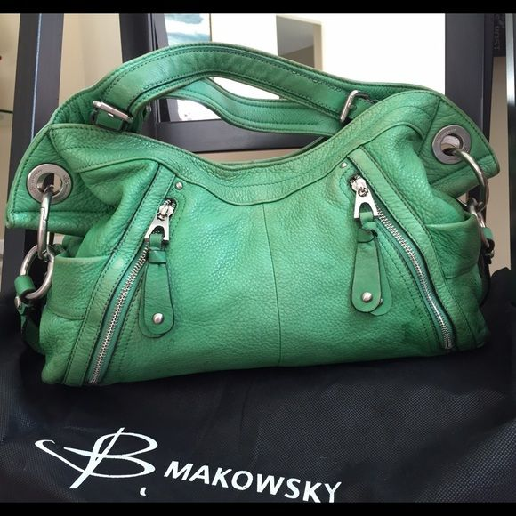Genuine leather purse This purse has every pocket you need! Lots of nooks and crannies to store anything, zip closures and magnet closures. Supple leather in a great color gives this purse great appeal and easy handling! Badgley Mischka Accessories