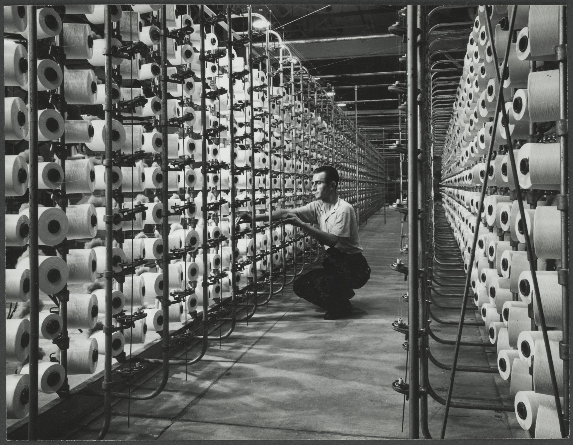 This Photograph, Taken Inside The Bruck Mill, Of A Worker