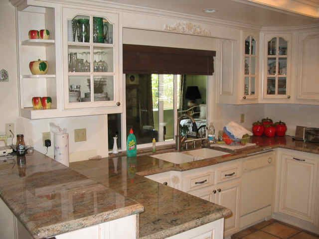 i like the raised breakfast bar and the cabinets with shelving to rh pinterest es