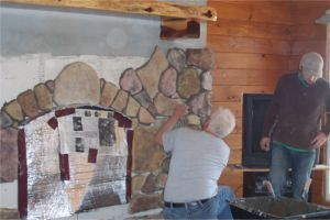 Joe molded every rock for the fireplace and master bath. Here he is setting the rock he crafted by hand.