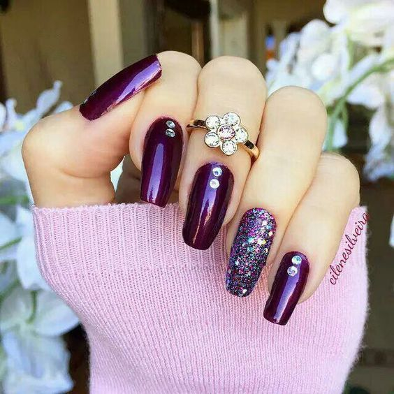 10 deep purple nails with an accent glitter nail and rhinestones - Styleoholic