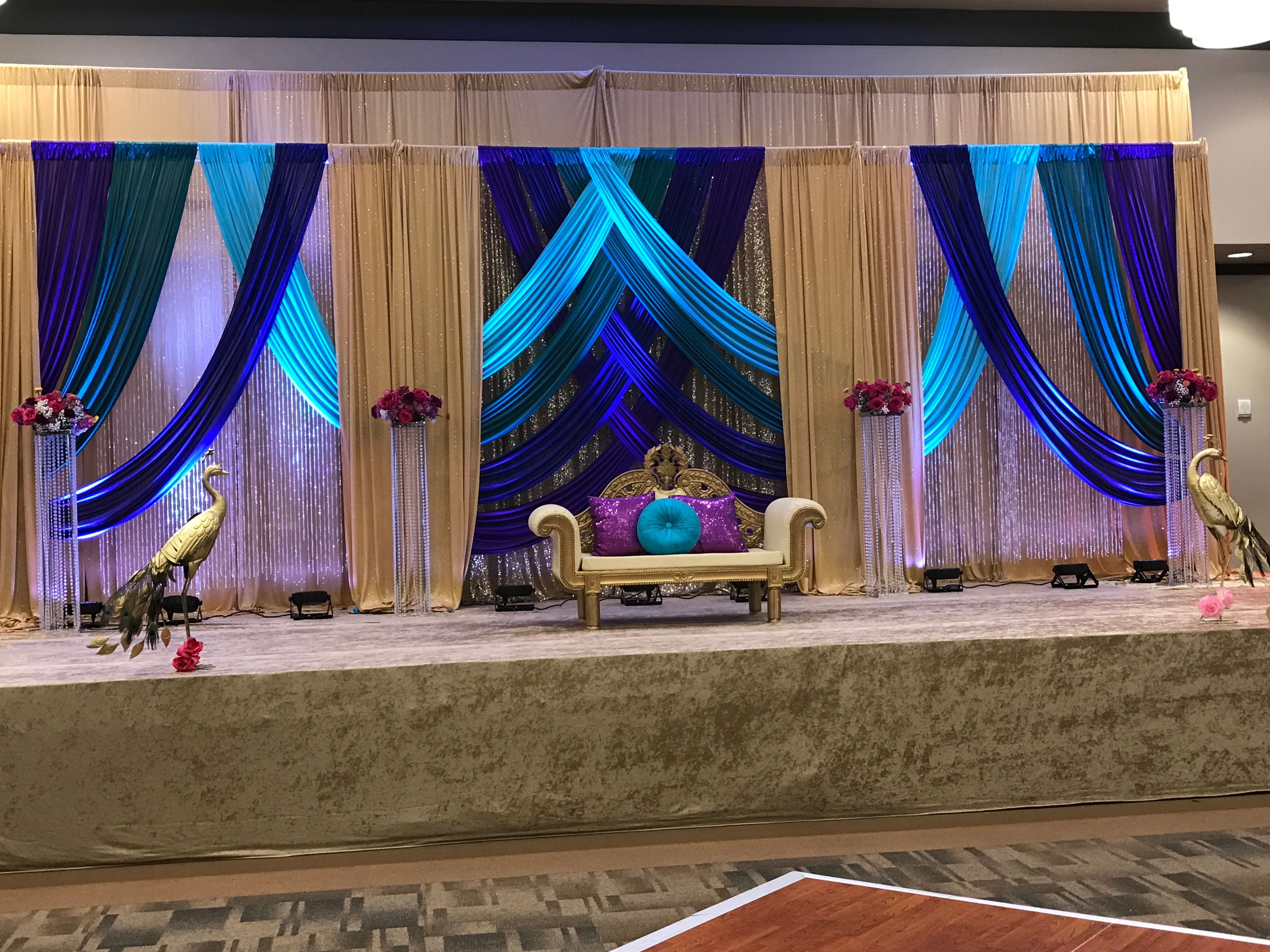 wedding stage decoration pics%0A Peacock colors Indian stage wedding reception decoration