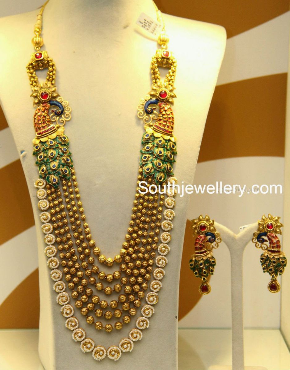 22 carat gold floral designer pendant with multiple beads chain and - 22 Carat Gold Antique Finish Gundla Haram Featuring Enamel Coated Peacock Motifs On Either Side And Adorned With Pearls And Kundans Paired With Matching