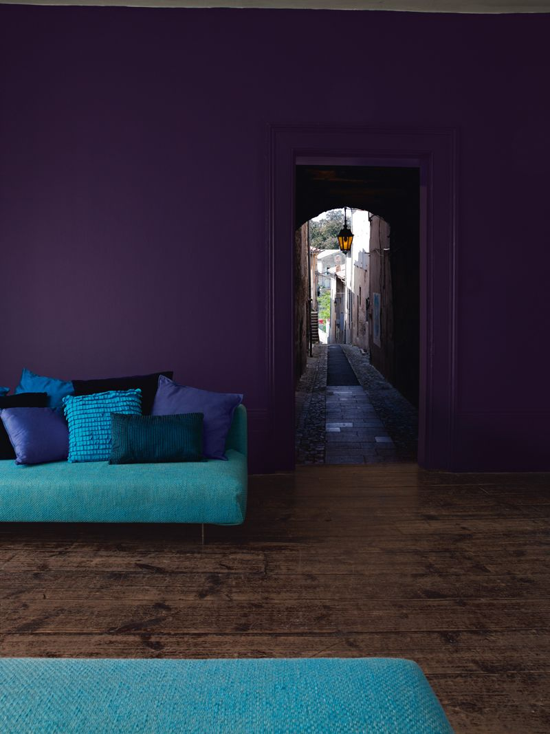 Purple accents in the living room darker shades of violet in this room - Lovely Dark Wood Floors With Deep Purple Walls And A Bright Accent Color Love It Find This Pin And More On Living Room