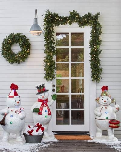 Our merry band of snowmen serenades you with the festive melodies of - outdoor snowman christmas decorations