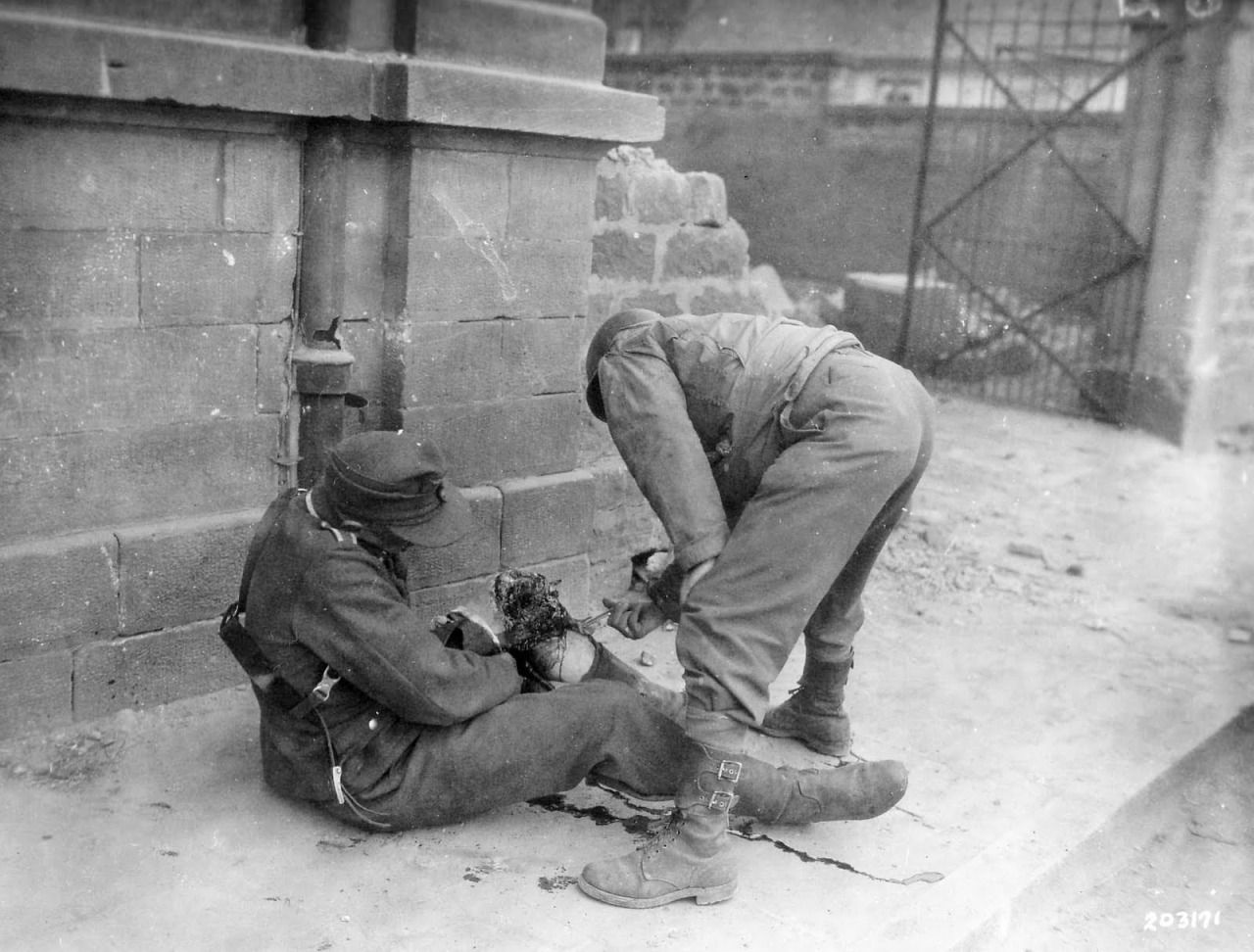An American soldier tending to a wounded