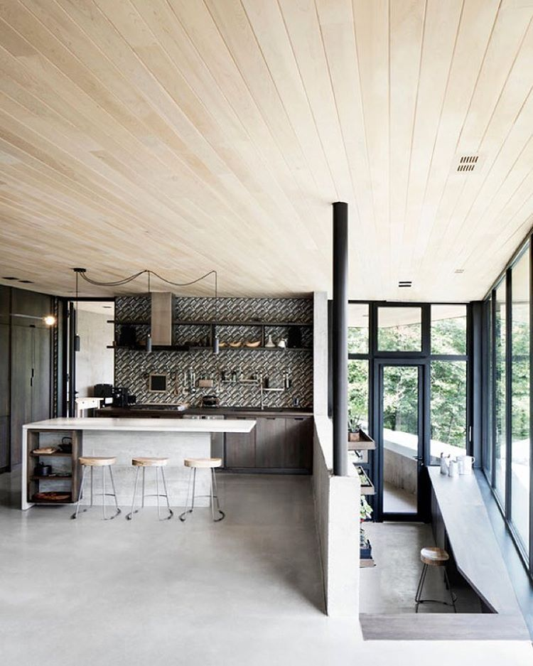 Alain Carle Architecte designed the kitchen in this Quebec house to