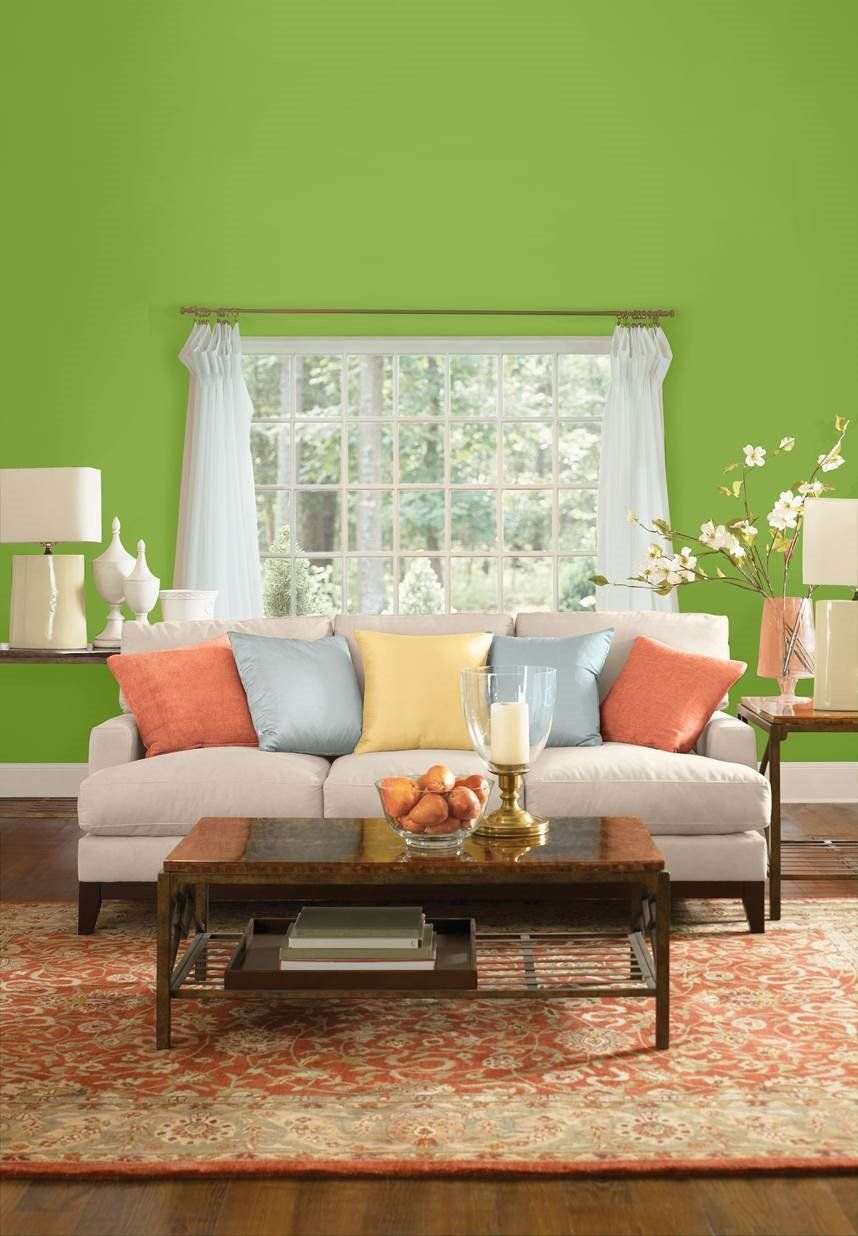 living room wall paint colors%0A Cheerful green walls add some pep to subdued shades in this living room   Asparagus
