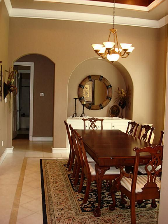 A Closer View Of The Dining Room Shows Arched Doorways