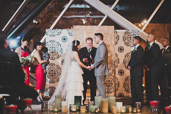 fabric panel walls backdrop - love this, but wonder about wind outdoors?  need to anchor down w/ heavy, heavy sandbags.  three vertical panels. love the candle detail up front, but it blocks the center aisle.