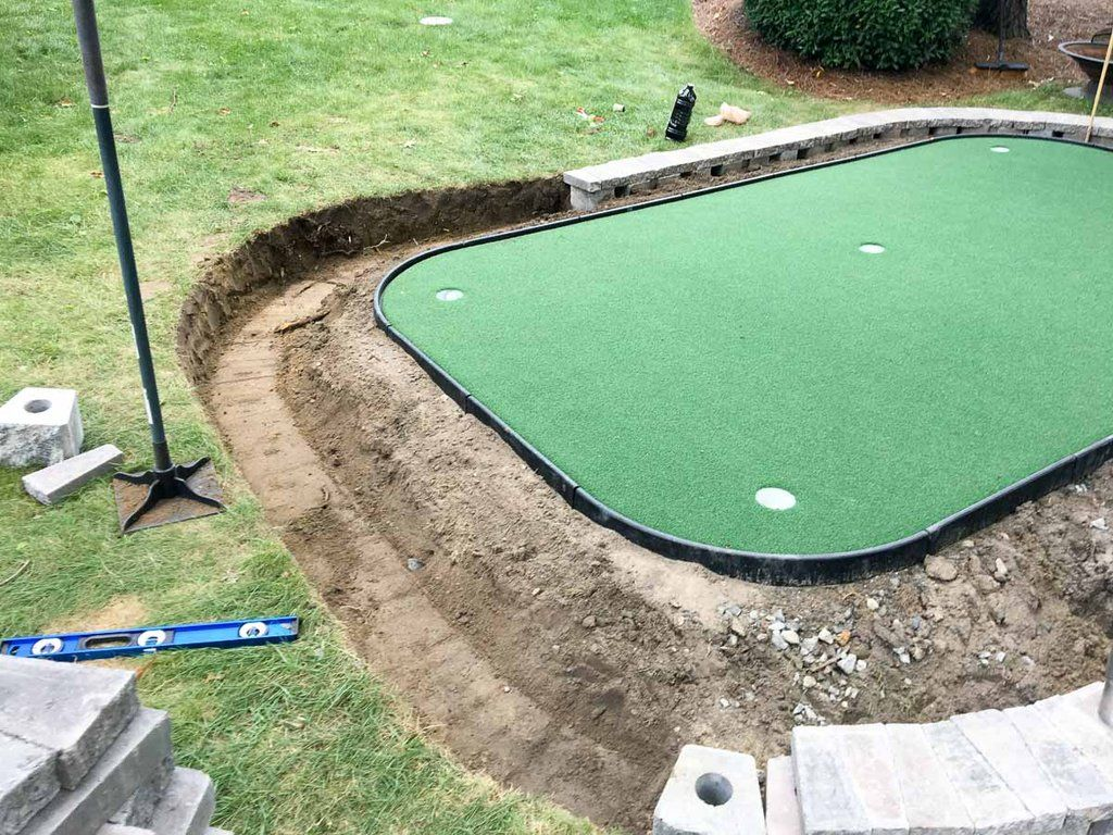 How to diy a stonebordered backyard putting green on the