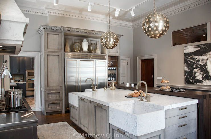gray kitchen island is topped with white quartz countertop and corner sinks in silstone helix quartz