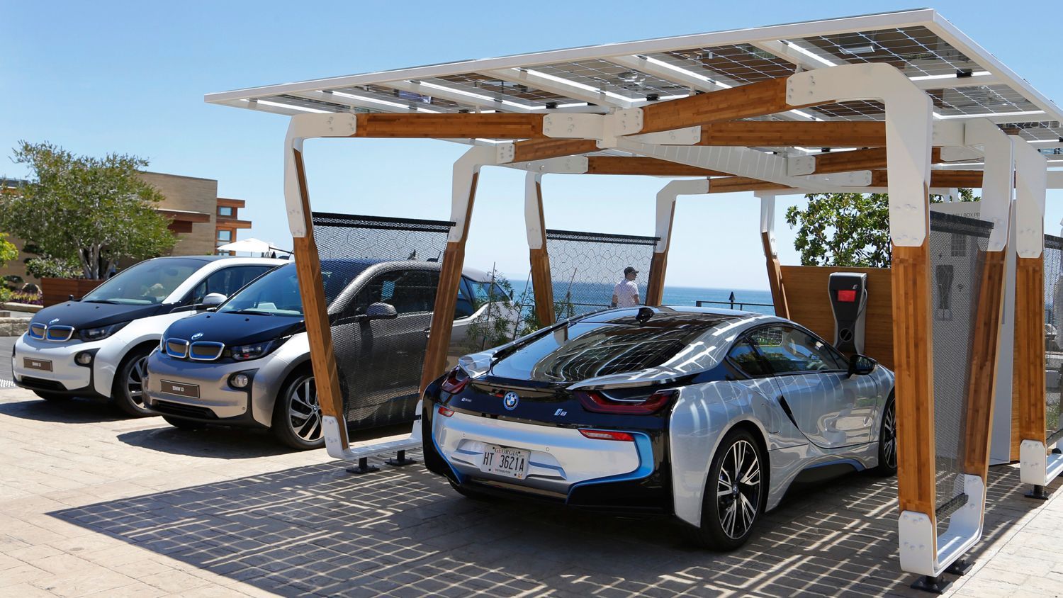 Bmw S Solar Powered Carport Is A Carbon Fiber And Bamboo Ecosculpture Solar Pergola Carport Designs Solar Car